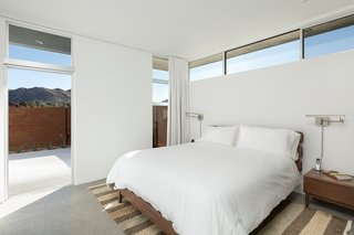 The master bedroom looks out at desert peaks.
