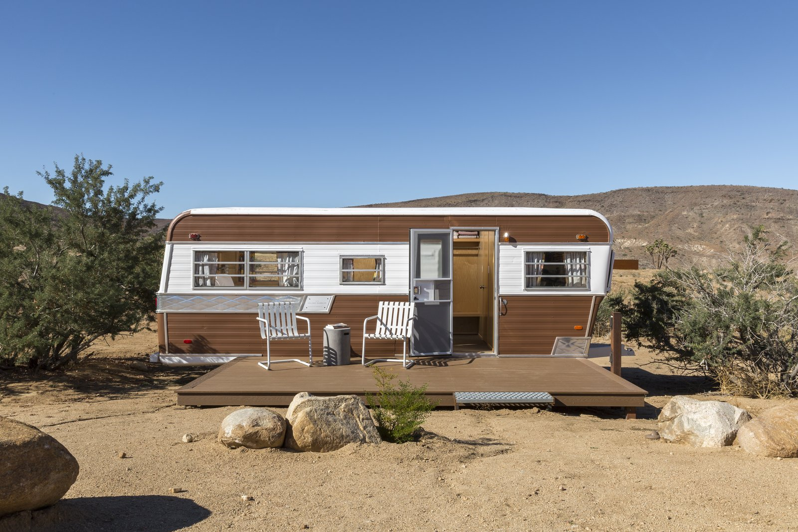 Revamped 1973 Holiday Rambler is now an all new living space. Tagged: Outdoor, Front Yard, Boulders, and Desert.  Photo 8 of 10 in This Modern Homestead With a Vintage Trailer Offers Adventure in California's High Desert