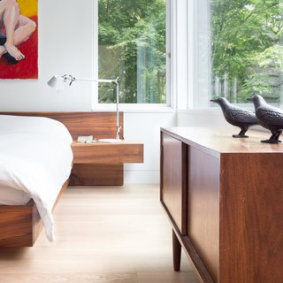 Custom Millwork and Bright Interiors Star in an Elegant Vancouver Home - Photo 9 of 9 - A custom platform bed by Christian Woo lies perfectly beneath the bedroom windows, which look out onto the greenery of the locale.