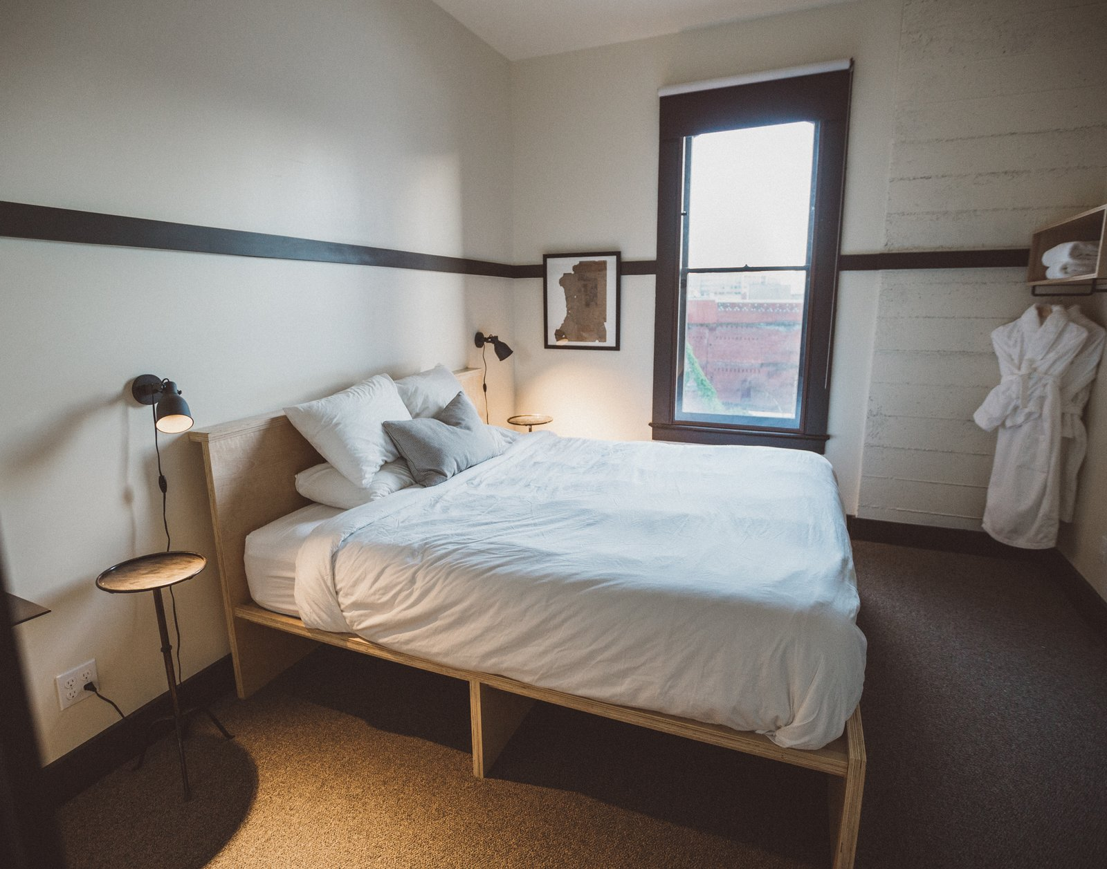 A variety of guest bedrooms fill the top three floors, in a configuration that closely matches the original plan of the hotel. Tagged: Bedroom and Storage.  Photo 8 of 11 in A Chic Portland Hotel Offers Lodging As Affordable as $35 a Night
