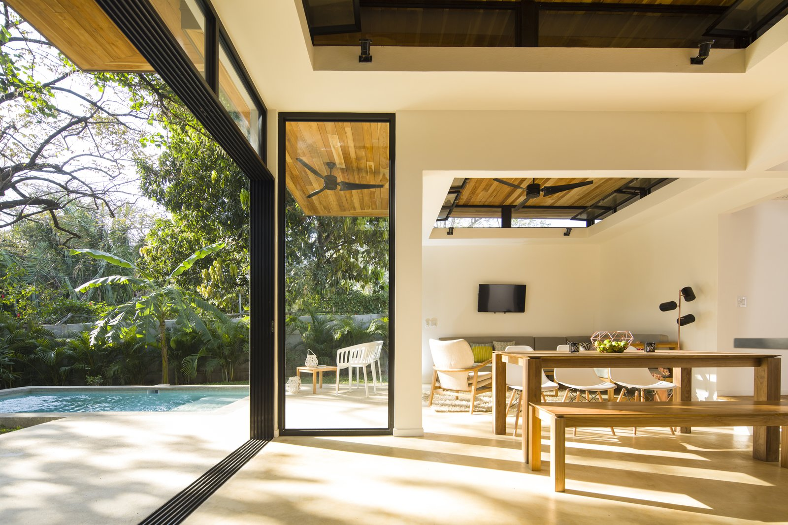Large, operable glass doors and clerestory windows provide a fluid transition between the interior retreat and the exterior landscape.  Photo 5 of 11 in Decompress at This Boutique Hotel and Yoga Retreat in the Costa Rican Jungle