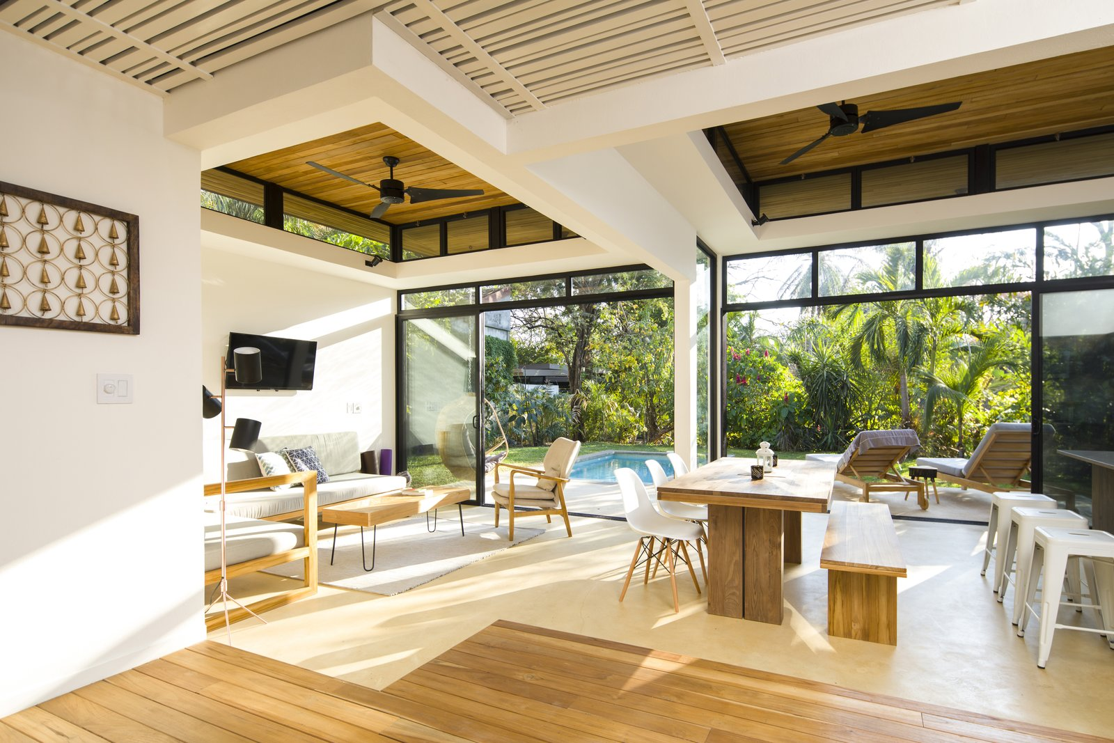 The wood tones in the ceiling are reflected in wood flooring and wood furniture introduced throughout the floor plan, adding warmth and texture. Decompress at This Boutique Hotel and Yoga Retreat in the Costa Rican Jungle - Photo 6 of 11
