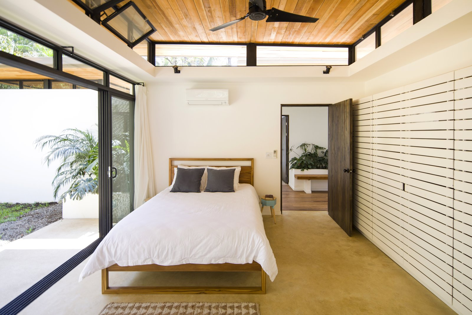Similar to the open spaces, the sleeping quarters have operable, sliding glass doors and clerestory windows allow the tropical air to freely pass between the exterior and interior.  Photo 7 of 11 in Decompress at This Boutique Hotel and Yoga Retreat in the Costa Rican Jungle