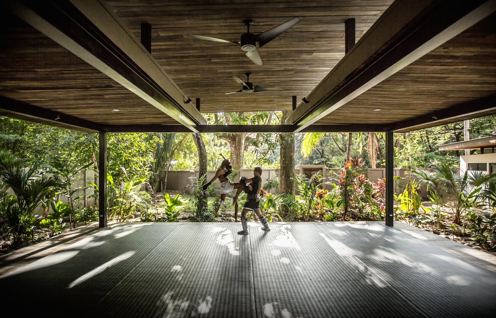 The yoga studio is surrounded on all sides by the jungle.  Light, shadows, and wind pass through the open structure.  Photo 10 of 11 in Decompress at This Boutique Hotel and Yoga Retreat in the Costa Rican Jungle