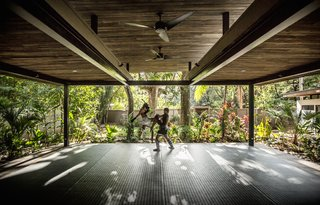 Decompress at This Boutique Hotel and Yoga Retreat in the Costa Rican Jungle - Photo 9 of 10 - The yoga studio is surrounded on all sides by the jungle.  Light, shadows, and wind pass through the open structure.
