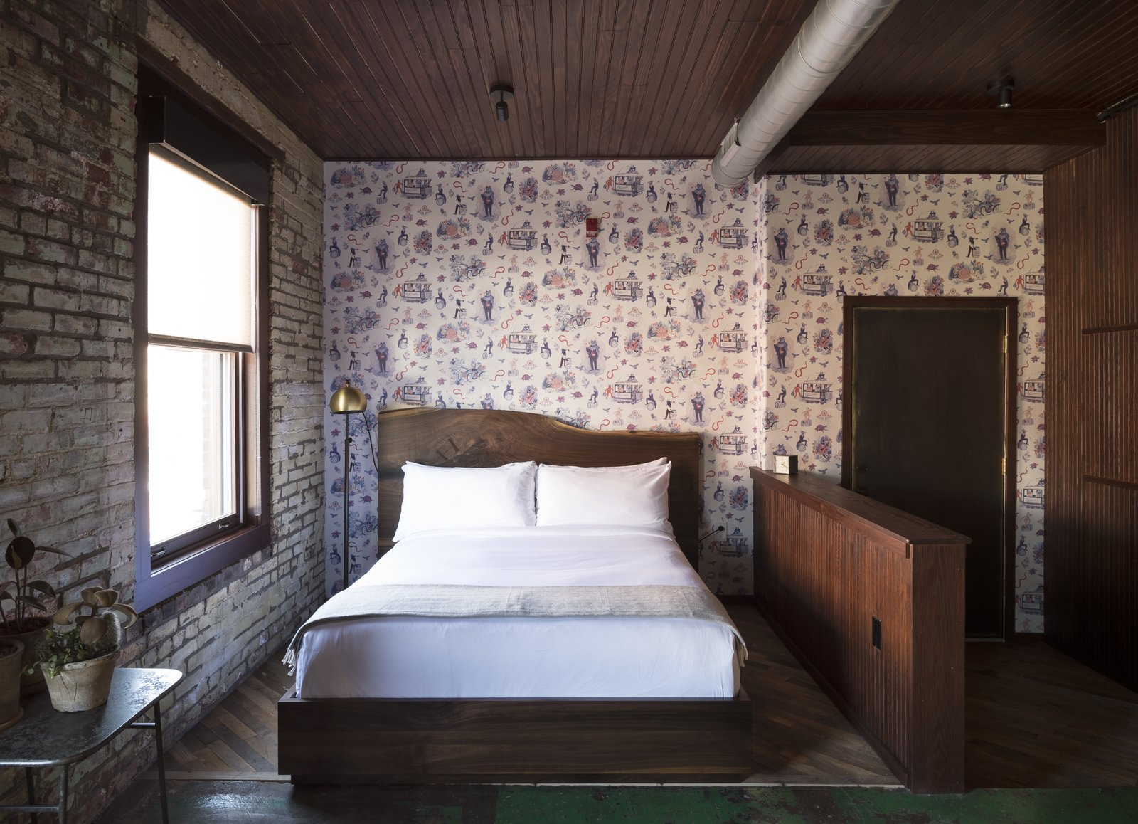 Tagged: Bedroom, Bed, Rug Floor, Floor Lighting, Accent Lighting, and Concrete Floor. History and Modernity Meet in This Industrial Hotel and Restaurant in Philadelphia - Photo 4 of 11