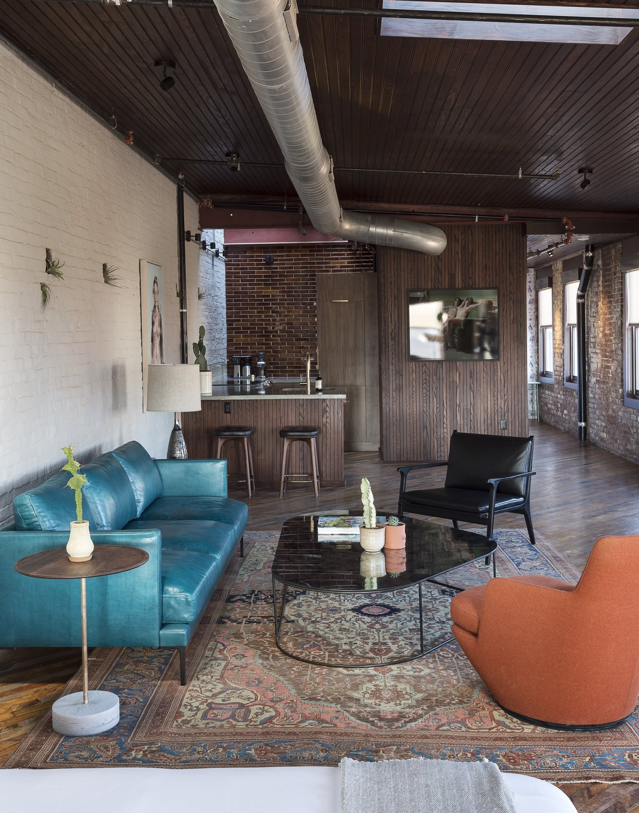 Tagged: Living Room, Coffee Tables, Chair, Sofa, End Tables, Concrete Floor, Table Lighting, Rug Floor, and Accent Lighting.  Photo 5 of 11 in History and Modernity Meet in This Industrial Hotel and Restaurant in Philadelphia