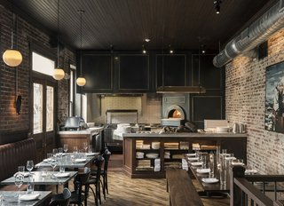 History and Modernity Meet in This Industrial Hotel and Restaurant in Philadelphia - Photo 9 of 11 - An open kitchen concept connects the wood-fired oven with the communal dining room.