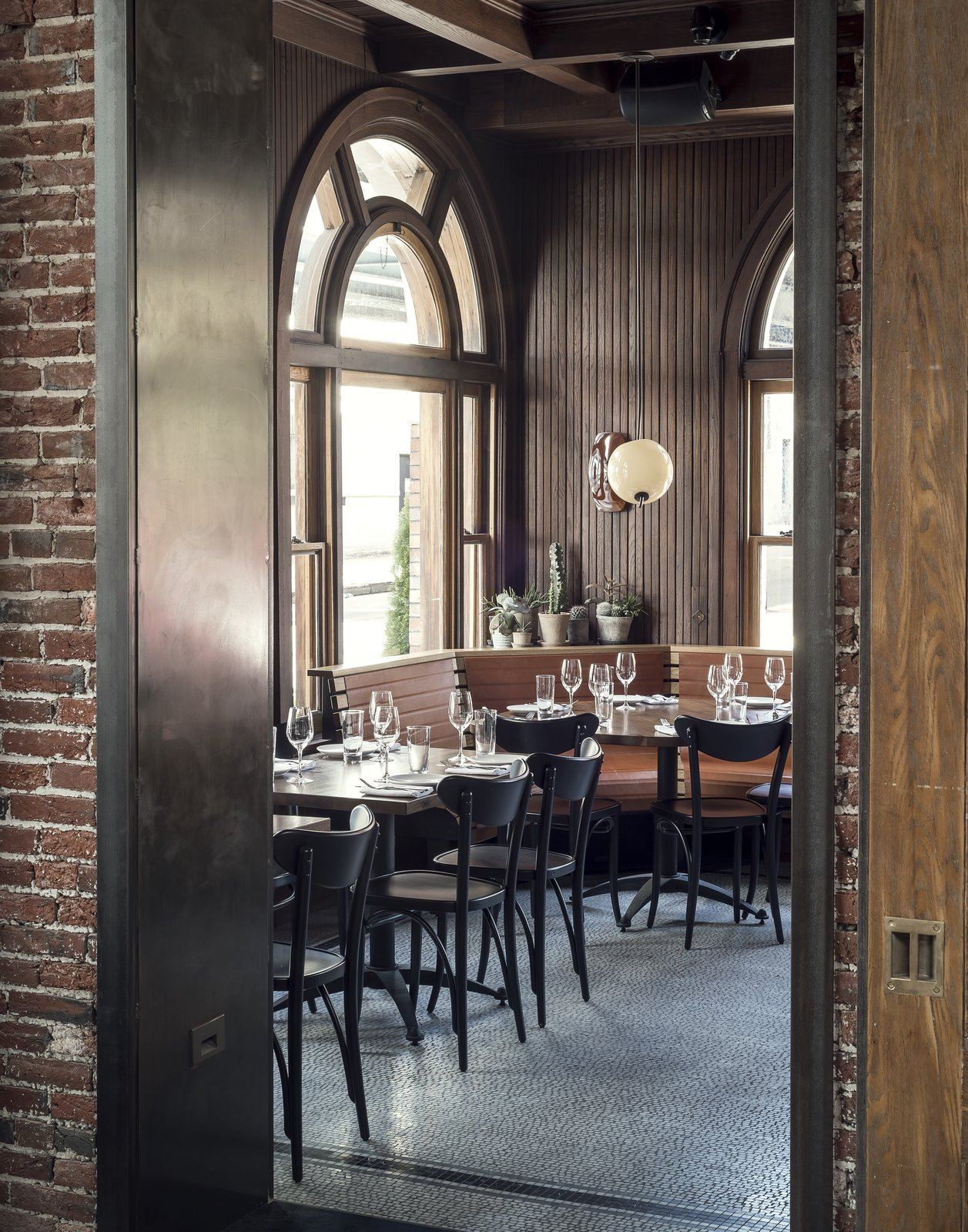 Simple pendant lighting, succulent greenery, and leather booths are simple, thoughtful elements that decorate the chic eatery.