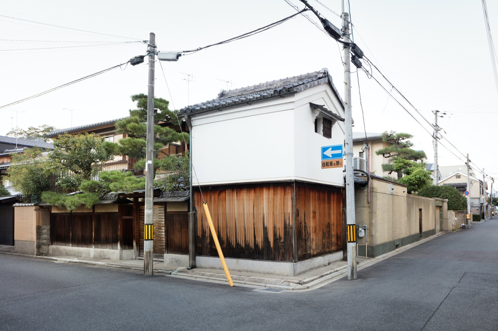 Tagged: Exterior, Wood Siding Material, House, Gable RoofLine, Stucco Siding Material, and Tile Roof Material.  Photo 1 of 13 in A Minimalist Townhouse Provides Serene Accommodations in Historic Kyoto