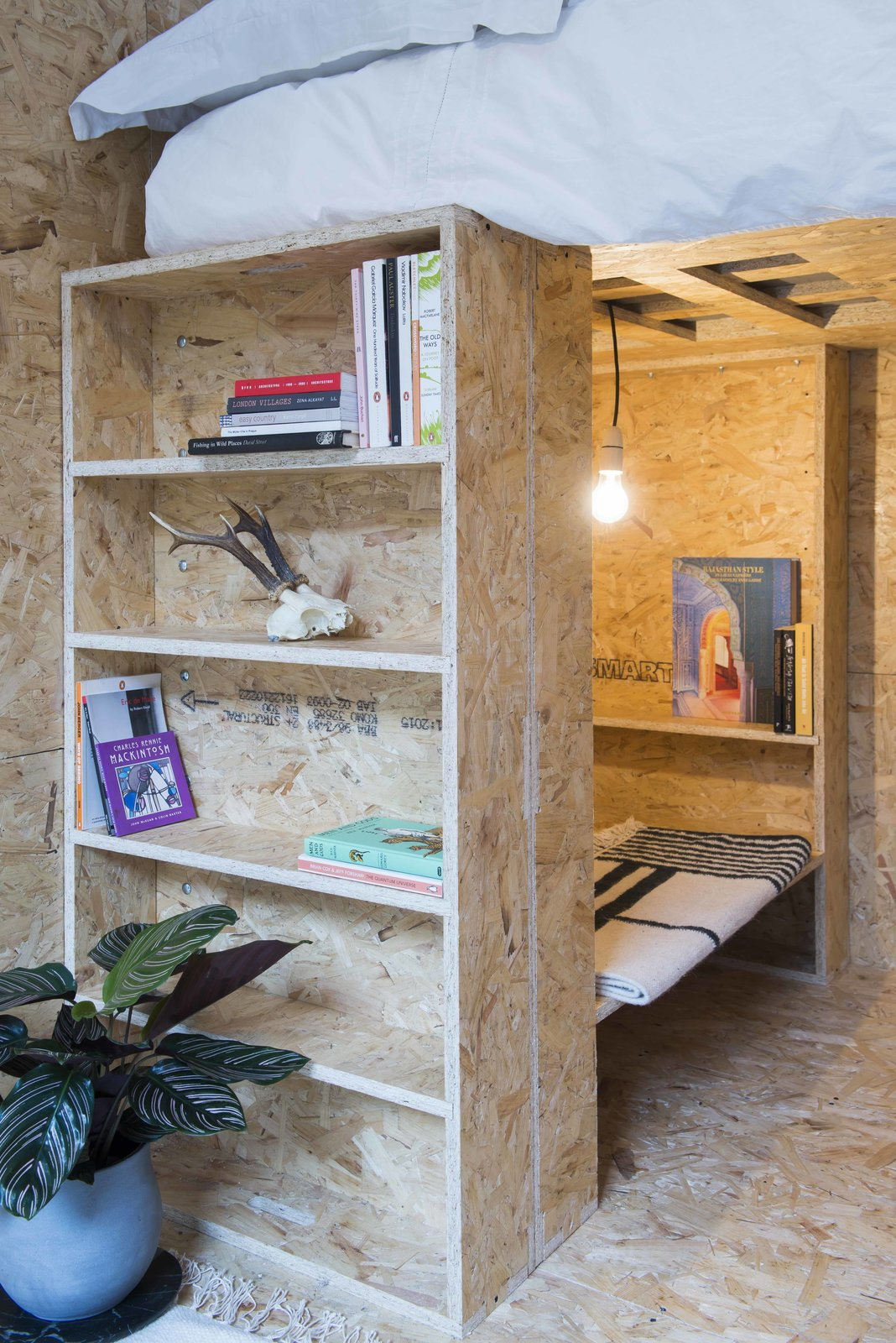 Tagged: Storage, Bunks, Bookcase, Bed, Ceiling Lighting, Shelves Storage Type, Shed & Studio, and Living Space.  Photo 7 of 9 in A New Concept For Modular, Affordable Housing Is Coming to London's Vacant Buildings