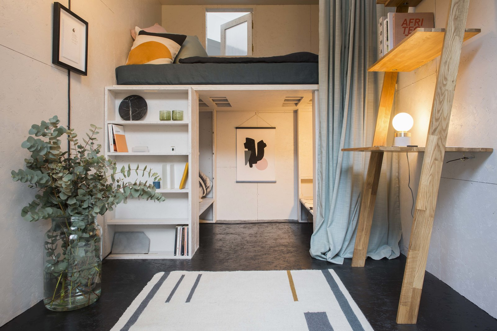 Tagged: Bench, Lamps, Desk, Shelves, Storage, Bookcase, Table Lighting, Accent Lighting, Bunks, Bed, Windows, and Wood.  Photo 9 of 9 in A New Concept For Modular, Affordable Housing Is Coming to London's Vacant Buildings
