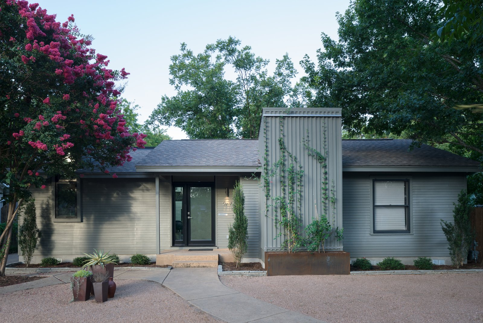 The front elevation of the home remained modest in appearance with a simple vertical addition, maintaining the typical Austin bungalow aesthetic. Tagged: Outdoor, Walkways, Front Yard, Trees, Hardscapes, and Shrubs.  Best Outdoor Walkways Hardscapes Photos from Bringing Light Into a Modest 1940s Bungalow in Austin