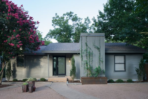 The front elevation of the home remained modest in appearance with a simple vertical addition, maintaining the typical Austin bungalow aesthetic.