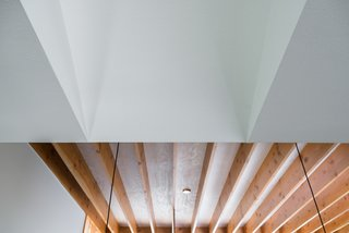 Bringing Light Into a Modest 1940s Bungalow in Austin - Photo 10 of 10 - The plywood roof deck is left exposed as the finished ceiling product. A pickling stain has been adhered to lighten the tone and subdue the grain pattern, thus providing a reflective surface and a warm, natural element.