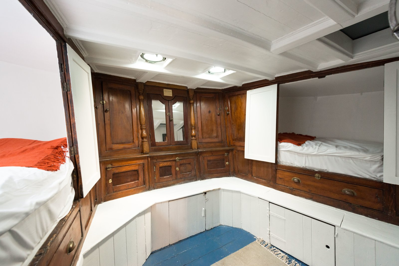 The bunk room provides built in sleeping quarters within the original woodwork. Tagged: Bedroom, Storage, Ceiling Lighting, Bunks, and Rug Floor.  Photo 6 of 9 in Londoners Can Live in This Scandinavian-Inspired, Converted Barge For $424K