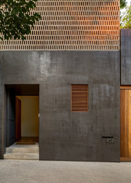 The black finish on the exterior facades is a modern interpretation of Corey, the artisan stucco used in traditional Mexican Cities.
