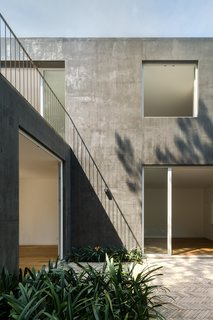 Delightful Material Contrasts Define a Courtyard Home in Mexico City - Photo 9 of 10 -