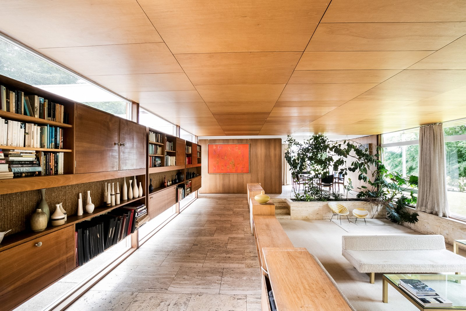 Tagged: Living Room, Sofa, Chair, Coffee Tables, Storage, Shelves, and Travertine Floor.  Photo 4 of 11 in The Iconic, Midcentury Home That Peter Womersley Designed For Bernat Klein Asks $1.02M
