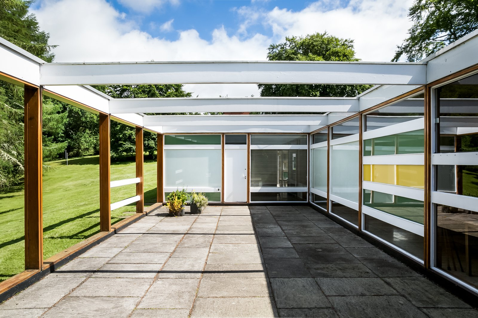 Tagged: House, Wood Siding Material, Metal Siding Material, Concrete Siding Material, Outdoor, Trees, Grass, Side Yard, Concrete Patio, Porch, Deck, and Hardscapes. The Iconic, Midcentury Home That Peter Womersley Designed For Bernat Klein Asks $1.02M - Photo 3 of 11