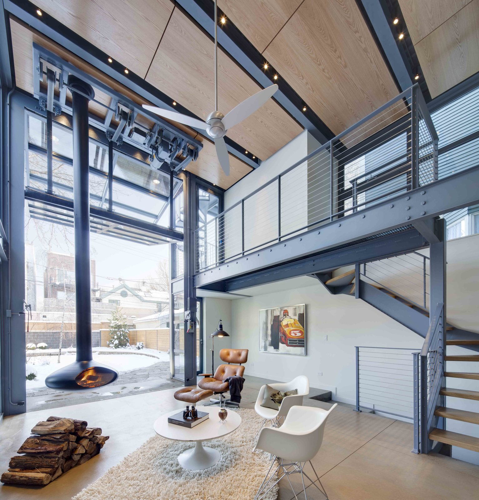 a steel and glass addition with a giant hangar door maximizes