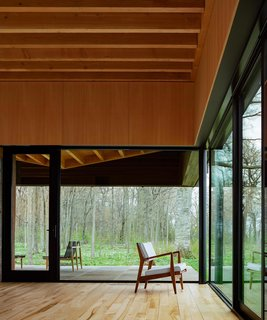 A Dramatic Cantilevered Roof Creates a Spacious Terrace Overlooking Lake Michigan - Photo 5 of 11 - Large sliding glass doors create seamless indoor/outdoor living.