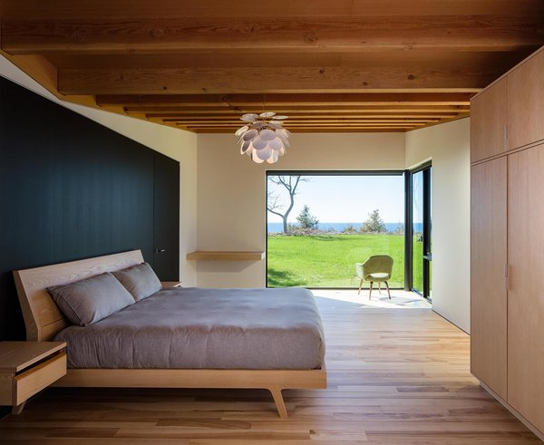 The master suite has a large, corner window that creates a private, interior terrace for enjoying the natural landscape.
