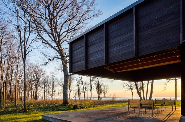 The dramatic cantilever provides shade and protection, while leaving views to the lake plentiful.