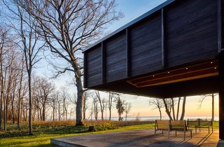 A Dramatic Cantilevered Roof Creates a Spacious Terrace Overlooking Lake Michigan - Photo 10 of 11 - The dramatic cantilever provides shade and protection, while leaving views to the lake plentiful.
