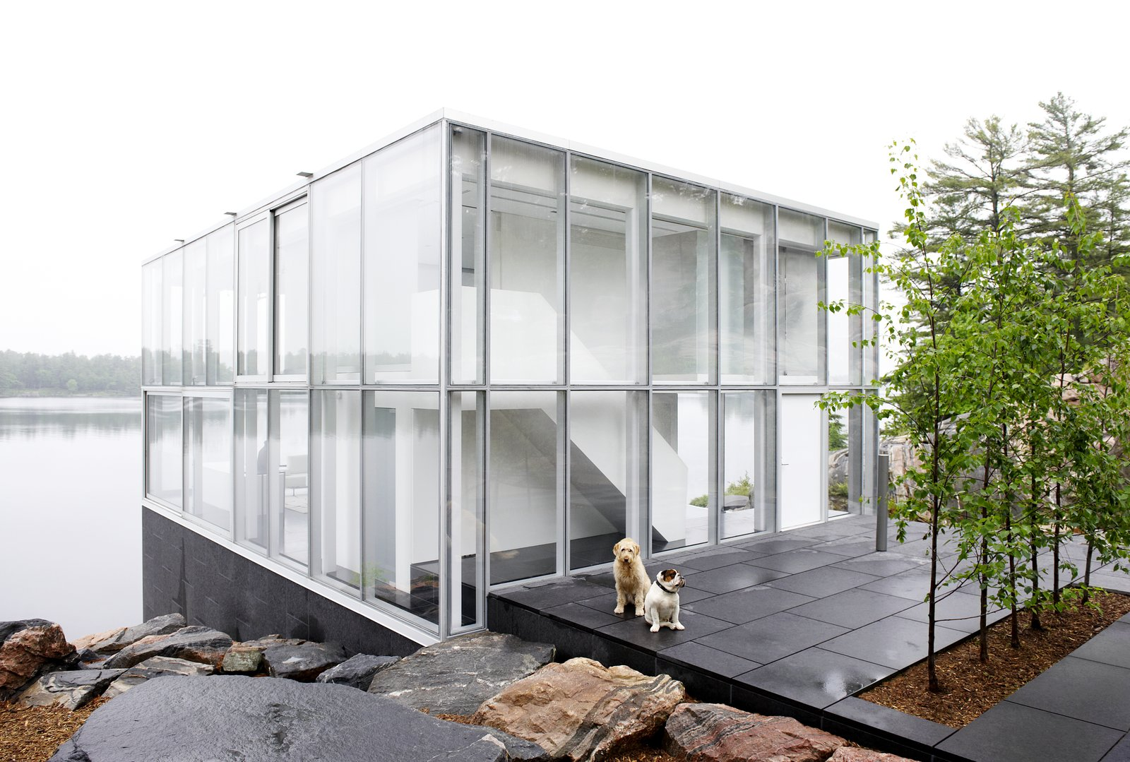 Tagged: Exterior, House, and Glass Siding Material.  Best Photos from This Mesmerizing Glass House Is Also a Photographer's Lakeside Studio