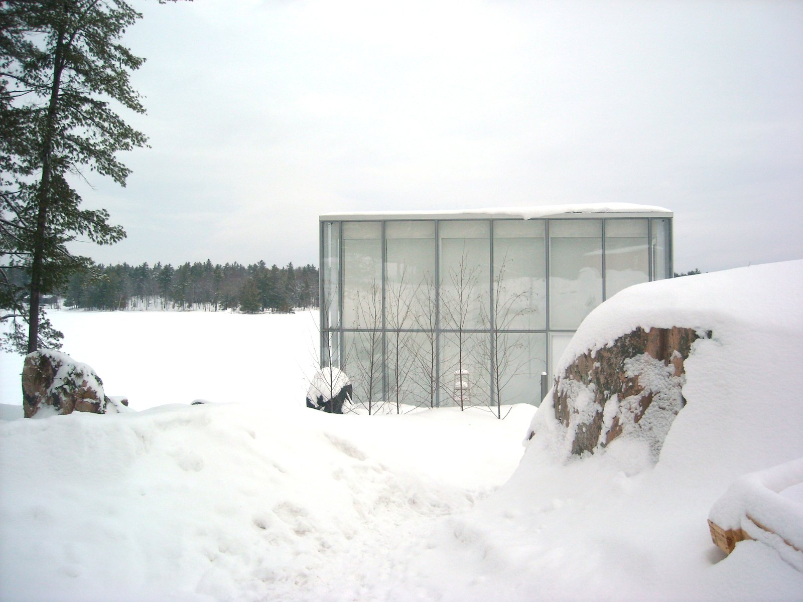 Tagged: Exterior, House, Glass Siding Material, and Flat RoofLine.  winter by Molly E. Osler, Interior Design from This Mesmerizing Glass House Is Also a Photographer's Lakeside Studio