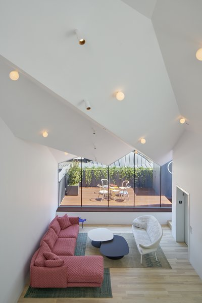 Entertainment and dining spaces sit below the angular roof in the penthouse.