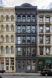 "A Hidden Penthouse Sits Atop a Historic Cast-Iron Building in New York - Photo 3 of 16 - Earning the nickname ""The Obsidian Building,"" the charcoal gray facade conceals the penthouse and modern renovations from the street level."