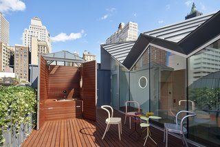 A Hidden Penthouse Sits Atop a Historic Cast-Iron Building in New York - Photo 15 of 16 - The former elevator bulkhead has been repurposed into a hot tub.