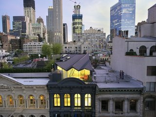 Hidden Penthouse Sits Atop Historic Cast Iron Building in New York