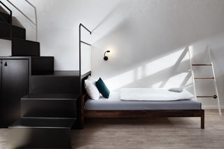 A Stylish Hostel in a Historic Czech Fortress Starts at $16 a Night - Photo 6 of 19 - Modern, bent metal stair treads and risers lead to the upper sleeping quarters.