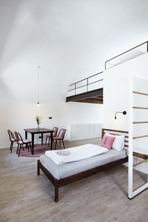 A Stylish Hostel in a Historic Czech Fortress Starts at $16 a Night - Photo 10 of 19 - The Girls' Choice, a six-bed dorm, is complete with a custom built mezzanine floor.