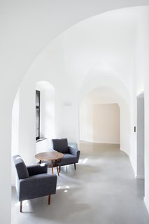 A Stylish Hostel in a Historic Czech Fortress Starts at $16 a Night - Photo 12 of 19 - Informal lounge spaces along the arched corridor provide ample opportunities for interaction between travelers.