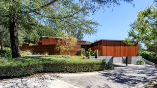 An Award-Winning Midcentury Residence in Los Angeles County Asks $3.9M - Photo 1 of 17 - The cedar clad exterior sits atop a concrete foundation.