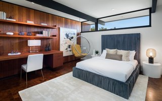 An Award-Winning Midcentury Residence in Los Angeles County Asks $3.9M - Photo 8 of 17 - Custom built-ins provide an office space and storage in a guest bedroom.  A hanging midcentury modern orb chair adds a touch of retro flair.