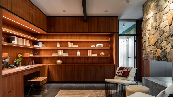 Custom L-Shaped open shelving provides ample storage in the office.