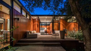 An Award-Winning Midcentury Residence in Los Angeles County Asks $3.9M - Photo 16 of 17 - Transom windows and full-height glazing provide seamless connections between interior and exterior spaces.