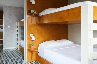 This Revived New Orleans Motel Has Some Serious Flair - Photo 9 of 11 - The bunk room, located on the first floor, has direct pool access.  Custom built-in bunk beds provide the perfect accommodations for a group of friends.
