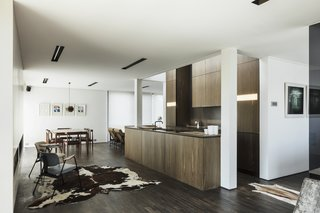 A Fantastic Renovation in Belgium Rescues a Bauhaus-Inspired Home - Photo 7 of 11 - Bog oak wood cabinets fill the kitchen space.