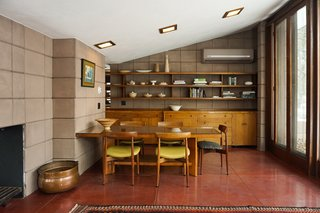 You Can Now Rent Frank Lloyd Wright's Gloriously Restored Eppstein House - Photo 5 of 13 - The dining table is original to the house. A glass top now sits on top to preserve the surface from further wear and tear. H.W. Klein #250 dining chairs manufactured by Bramin complement the table.