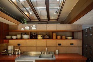 You Can Now Rent Frank Lloyd Wright's Gloriously Restored Eppstein House - Photo 7 of 13 - Open shelving continues into the kitchen. A wood-framed skylight above draws natural light into the space.
