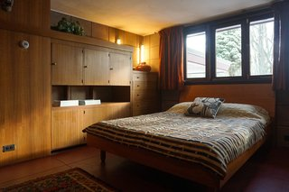 You Can Now Rent Frank Lloyd Wright's Gloriously Restored Eppstein House - Photo 10 of 13 - Built-in millwork provides ample storage in the bedroom spaces. Danish teak beds with midcentury textiles resemble the original furnishings.