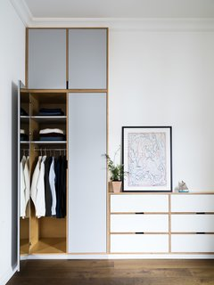 A Sleek Renovation in London Ushers Light Into a Family Home - Photo 8 of 11 - Wardrobe closets display the exposed ply edges, which create a unique outline within the millwork.