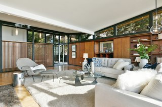 A Bay Area Jewel With Golden Gate Views Wants $1.55M - Photo 3 of 14 - Continuous clerestory windows provide views out into the surroundings from all edges. The butterfly roof appears to hover atop the structure.