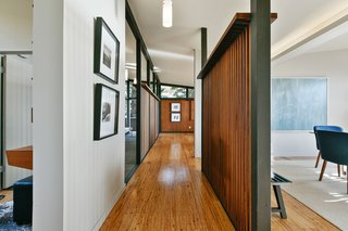 A Bay Area Jewel With Golden Gate Views Wants $1.55M - Photo 5 of 14 - The central gallery, framed by wood screen walls on both sides, links the main living spaces.  The partitions create a more open, expansive volume.